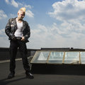 Punk standing on roof. Royalty Free Stock Images