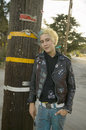Punk teenager with blond and blue hair Royalty Free Stock Photo