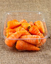 Punnet of baby carrots on a jute sack Stock Image