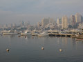 Punta del este beach uruguay in a marina with boats and a line of buildings on a foggy day Stock Photos