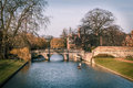 Punting at cambridge landscape showing cambridge river side and bridge Royalty Free Stock Photos