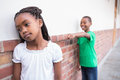 Pupil bullying another in the hall at elementary school Royalty Free Stock Images