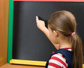 Pupil draws on a chalk board Stock Photos