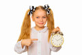 Pupil pointing to clock. Time management concept. Royalty Free Stock Photo