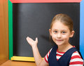 Pupil points hand on blackboard primary school Stock Image