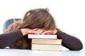 Pupil sleeping on her books fatigued the stack of Royalty Free Stock Image