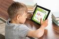 Pupil Solving Math Problem On Digital Tablet Royalty Free Stock Photo