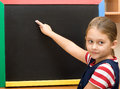 Pupil writes with chalk primary school Stock Image