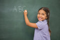 Pupil writing on large blackboard Royalty Free Stock Photo