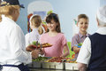 Pupils Being Served With Healthy Lunch In School Canteen Royalty Free Stock Photo