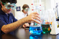 Pupils carrying out experiment in science class close up of Royalty Free Stock Image