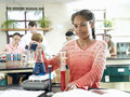 Pupils doing science experiments at desks in classroom focus on teenage girl in foreground Royalty Free Stock Photo