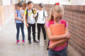 Pupils friends teasing a pupil alone Royalty Free Stock Photo
