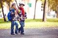 Pupils going to school portrait of happy twin schoolboys Stock Photos