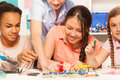 Pupils learning physics, assembling electric chain Royalty Free Stock Photo