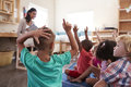 Pupils At Montessori School Raising Hands To Answer Question Royalty Free Stock Photo