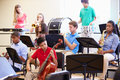 Pupils Playing Musical Instruments In School Orchestra Royalty Free Stock Photo