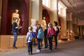 Pupils And Teacher On School Field Trip To Museum With Guide Royalty Free Stock Photo