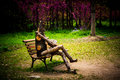 Puppet in melancholy sit on the bench looks Royalty Free Stock Image