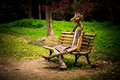 Puppet in melancholy sit on the bench looks Royalty Free Stock Photos