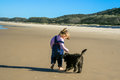 Puppy and child on the beach Royalty Free Stock Photo
