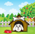 A puppy inside a doghouse near an apple tree illustration of Royalty Free Stock Photos