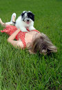 Puppy and pretty girl in grass Stock Photography