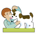 Puppy and vet a male is checking a s ear gettng a kiss from the both are very happy Royalty Free Stock Photography