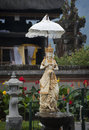 Pura ulun danu bratan bali statuary at the important hindu temple by lake in the mountains of with a traditional balinese umbrella Royalty Free Stock Image