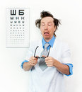Purblind oculist funny with eyes closed Stock Image