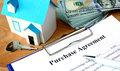 Purchase agreement document with home model. Royalty Free Stock Photo