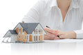 Purchase agreement for house woman signs a Stock Photo