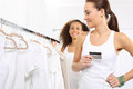 Purchases on credit woman in clothing store pay for by card Stock Images