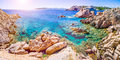 Pure clear azure sea water and amazing rocks on coast of Maddalena island, Sardinia, Italy