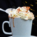 Pure decadence mug of hot chocolate with whipped cream and chocolate sprinkles Stock Photo