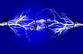 Pure energy and electricity symbolizing power with blue background Stock Images