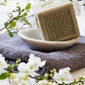 Pure green French olive oil solid soap in mineral cup Royalty Free Stock Photo