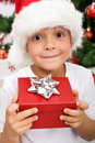 Pure happiness - boy with christmas present Royalty Free Stock Image