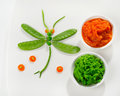 Pureed vegetables for baby with decoration on a white plate healthy food Royalty Free Stock Photography