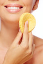 Pureness young woman cleaning her face with sponge Royalty Free Stock Photo