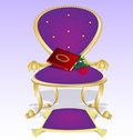 Purple armchair and red book with rose Stock Image