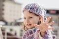 Purple Beret girl Shows Her Fingers Royalty Free Stock Photo