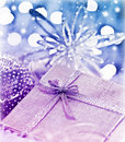 Purple blue Christmas gift with baubles decoration Stock Images