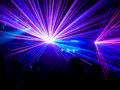Purple and blue club lasers in a Stock Images