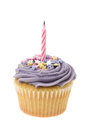 Purple buttercream iced cupcake with a single birthday candle Royalty Free Stock Photo