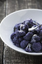 Purple cauliflower white bowl with roasted Stock Photography