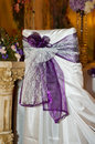 Purple chair cover at wedding reception Stock Photo