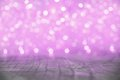 Purple christmas lights blur background with wooden floor Royalty Free Stock Images