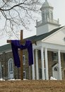 Purple cloth on the cross for lent a traditional a wooden outside a presbyterian church during Royalty Free Stock Images