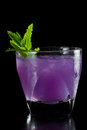 Purple cocktail closeup of a on a black background served on the rocks Stock Photography